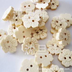 botones flores blancos