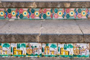 Close-up view of some steps of Caltagirone staircase with colored ceramic tiles portraying the characteristic sicilian cart