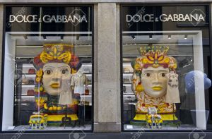MILAN, ITALY - APR 8: Dolce e Gabbana window in Milan on April 8 2014, featuring typical big head symbol of Sicilian ceramic