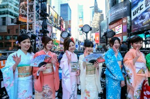 NEW YORK, NY - DECEMBER 31: Toshiba Kimono Girls attend the Japanese New Year Countdown at Times Square on December 31, 2013 in New York City. (Photo by Eugene Gologursky/Getty Images for Toshiba)