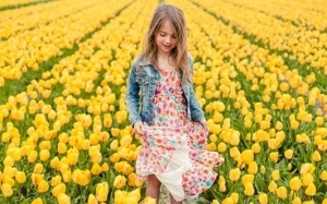 46670_fullimage_a girl surrounded by tulips in a field_492x307