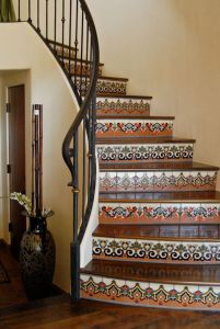 Malibu tile, walnut, and wrought iron stairs.