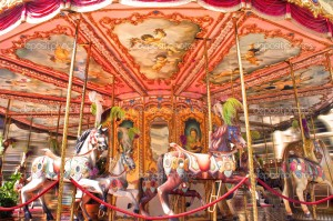 FLORENCE, ITALY - JUNE 25: Horse rides on a merry-go-round carousel on Piazza della Repubblica in Florence, Italy on June 25, 2013